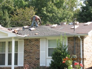 New felt has been applied and shingles are being installed